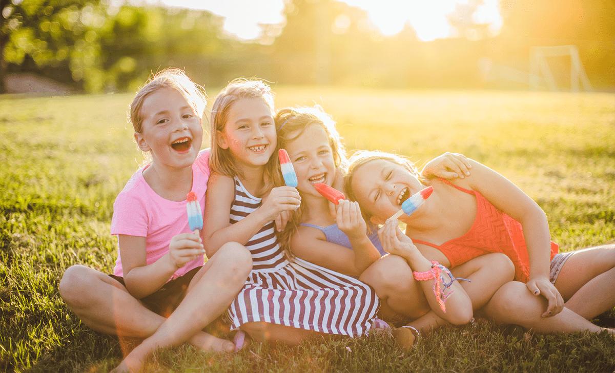Kids enjoying ice blocks at the park