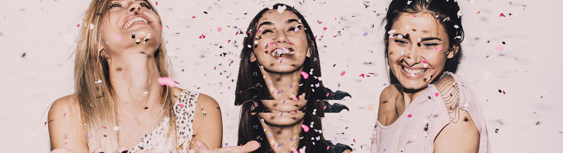 Three women covered in glitter